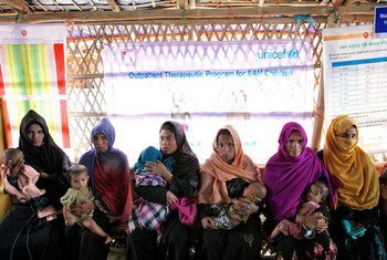 Rohingya refugee mothers wait for their children to be assessed at an Outpatient Therapeutic Feeding Programme (OTP) center at Unchiprang makeshift settlement in Teknaf, Cox's Bazar, Bangladesh, Tuesday 2 January 2018.