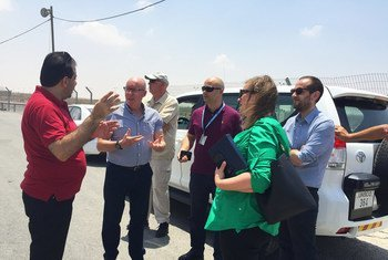 Jamie McGoldrick (2nd left), the UN Humanitarian Coordinator for the occupied Palestinian territory, receives a briefing at the Kerem Shalom crossing point into Gaza on July 17th.