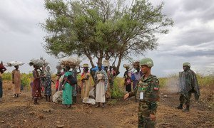 Ethiopian peacekeepers deployed to the United Nations Mission in South Sudan (UNMISS) escort a group of women outside a UN-run site and create a safe perimeter within which they can search for firewood without being at risk of attack, 28 March 2017.