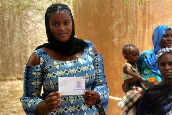 Ahead of Mali's 2018 presidential elections, this young women is picking up her new voter's card at an electoral station in Gao, in the country's north.