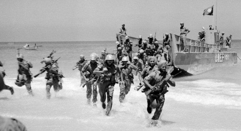 Indian peacekeepers take part in a United Nations Emergency Force (UNEF) exercise to practice evacuation and landing on a beach in Gaza in 1958.