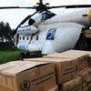 El Programa Mundial de Alimentos despliega un equipo de respuesta en Kitchanga, República Democrática del Congo, para repartir seis toneladas de galletas energéticas (Marzo 2013)