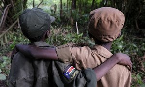 Two children released by armed groups in South Sudan stand during a release ceremony in Yambio before beginning a reintegration process.