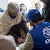 IOM staff register beneficiaries during a distribution for natural disaster-affected families in Afghanistan. March 2015.
