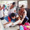 The Indonesian Red Cross evacuates children from the island of Lombok following the 5th August earthquake.
