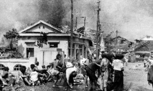 Injured civilians, having escaped the raging inferno, gathered on a pavement west of Miyuki-bashi in Hiroshima, Japan, about 11 a.m. on 6 August 1945.