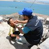 On 7 May 2018 in Aden, Yemen, a boy is vaccinated against cholera.