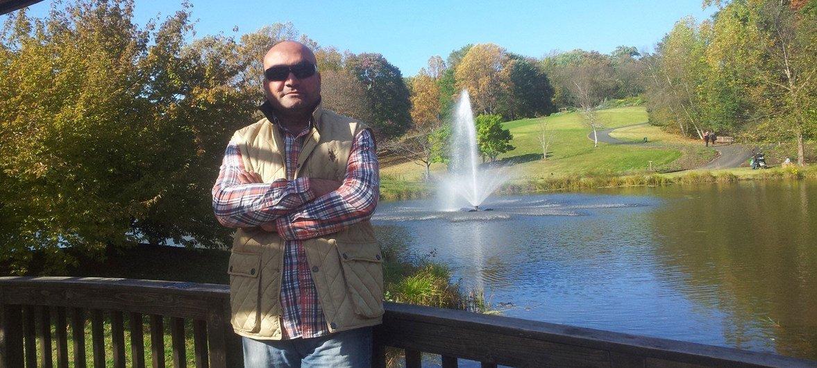 Муджахед Хассан во время поездки по США в 2013 г.