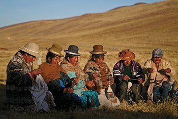 Indigenous men and women of Nuñoa in Puno, Peru, spin and weave garments based on the fiber of the alpacas.