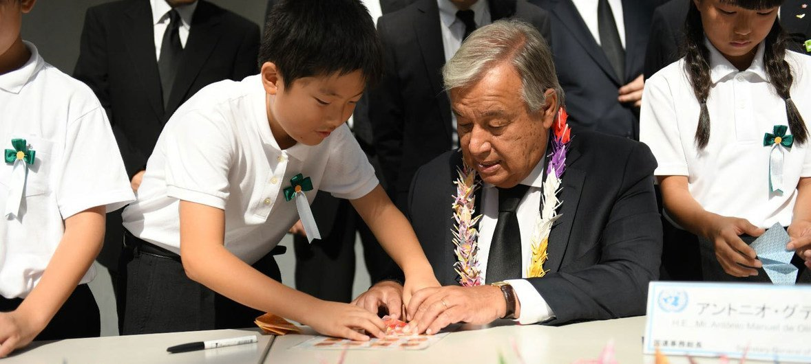 Secretary-General António Guterres folds origami cranes with young Japanese leaders at the Nagasaki Peace Memorial.