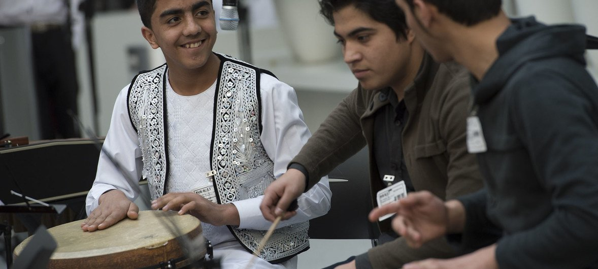 Students from the Afghanistan National Institute of Music, about half of whom are orphans and former street children and about one-third girls, play their instruments.