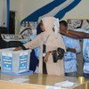 Electoral officials count votes during the electoral process to choose members of the Lower House of the Federal Parliament in Baidoa, Somalia in November 2016.