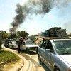 [FOTO DE ARCHIVO] Tras recibir amenazas y después que una milicia local demoliera muchas casas, las personas desplazadas de Tawergha recogen sus pertenencias para abandonar el asentamiento de Triq al Matar, en Trípoli, Libia.