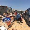 À Tripoli, en Libye, les personnes déplacées de Tawergha emballent désespérément leurs affaires pour fuir le site de Triq al Matar après avoir reçu des menaces et la démolition de nombreuses maisons par une milice locale.