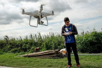 Digital technology being used to improve agricultural methods in the Philippines: Department of Agriculture experts, working with the Food and Agriculture Organization (FAO) using drones to gather visual data on recently damaged rice crops in Magalang town in Pampanga province.