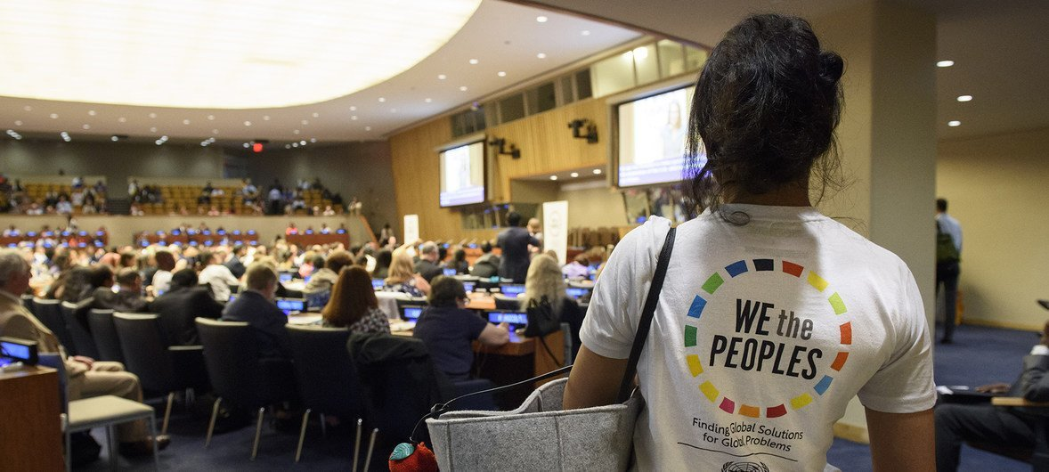 A young woman wears a shirt bearing the logo of the 67th DPI/NGO Conference at United Nations Headquarters in New York, 22 August 2018.