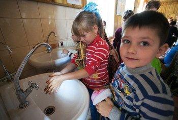 Children wash hands at the canteen of Secondary School No 20 in Toretsk, Donetsk region, Ukraine.