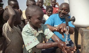 Teaching children how to correctly wash their hands to prevent the spread of Ebola near Mangina, North Kivu, the Democratic Republic of the Congo.