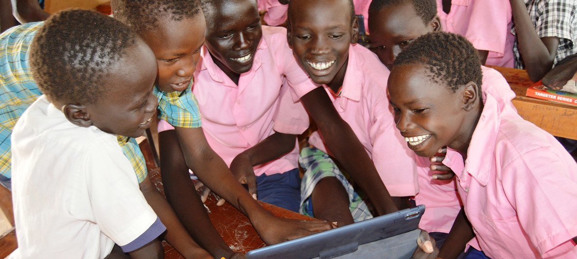 Students using tablets from the Instant Network Schools (INS) project in Kakuma Refugee Camp in Kenya.
