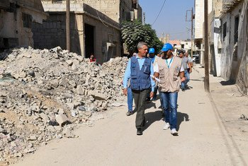 UN High Commissioner for Refugees Filippo Grandi (l) walks through the battle-scarred streets of Douma, in Syria's Eastern Ghouta suburb.