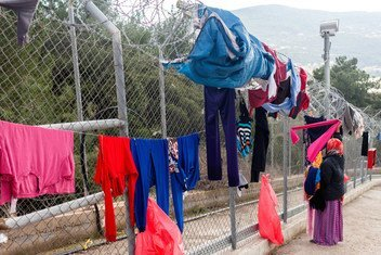 A woman hangs washing out to dry at the Vathy Reception and Identification Centre (RIC) on the island of Samos, Greece.   Refugee families are struggling at the reception centres on the island of Samos due to overcrowding, leading to deteriorating conditions.