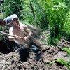 Workers clean a drainage channel around Bishkek, Kyrgyzstan.