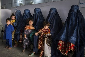 Afghan refugees, who have made the difficult decision to voluntarily return home to Afghanistan, some after decades living in Pakistan, here pictured at UNHCR's voluntary repatriation centre in Peshawar, which provides administration and services to help them go home.