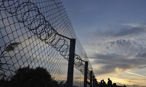 Hungary's strengthened razor wire border fence along an old railway line, to block the path of refugees and migrants. File photo, September 2015.