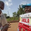 A UNICEF officer, talks to children about the importance of Ebola prevention in North Kivu, the Democratic Republic of the Congo.