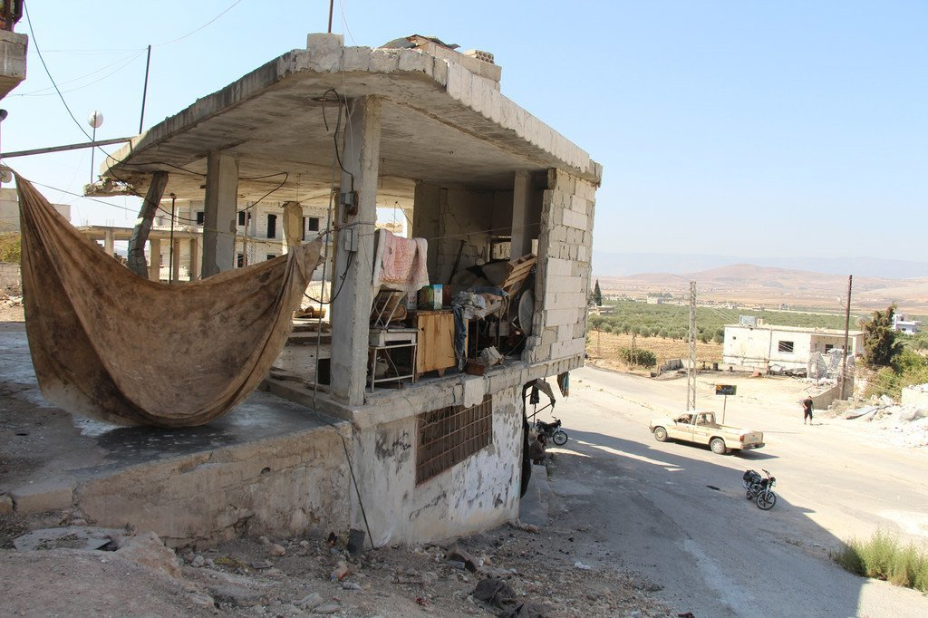 The humanitarian situation across Syria remains dire and millions across the war-torn country remain dependent on international assistance. Pictured here, a damaged building in Idlib, which is being used as a makeshift shelter.