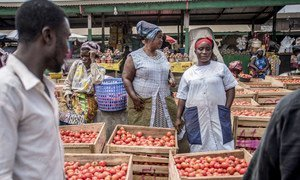 28 June 2018, Accra, Ghana. Women sell tomatoes at Agbogbloshie market. Agbogbloshie neighbourhood is internationally well known as its has one of the biggest electronic waste in the world.