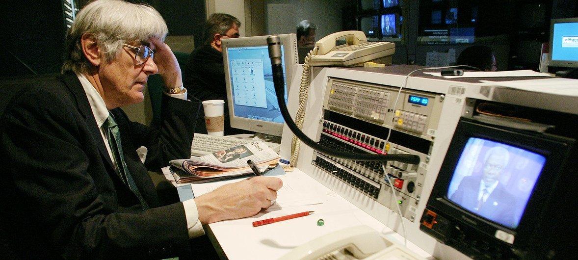 Edward Mortimer, head speechwriter for UN Secretary-General Kofi Annan, monitors a video recording by Mr. Annan.