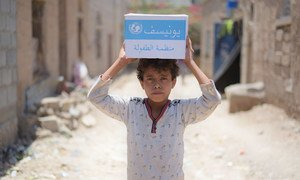 A 12-year-old boy carries soap supplied by the UN in the Bani Harith neighbourhood of Sana'a in Yemen. (September 2018)