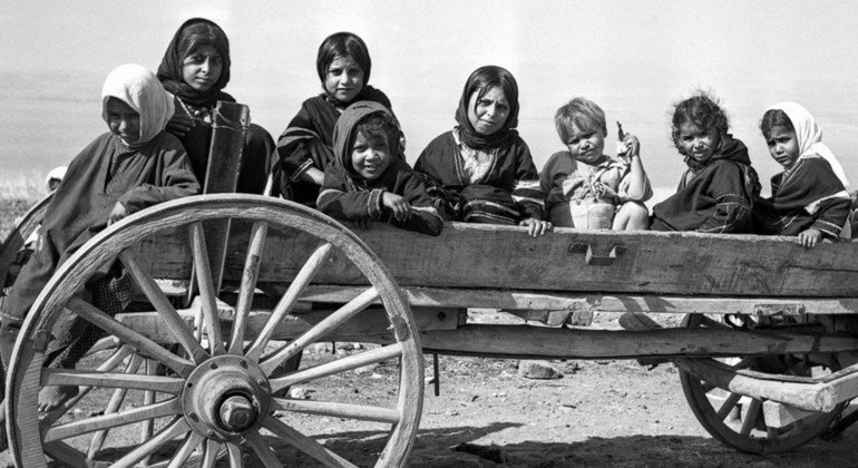 Palestinian refugee children in the U.N. demilitarized zone at Lake Tiberias (Sea of Galilee) on the Israeli-Syrian frontier. Tiberias, Israel. c.1950