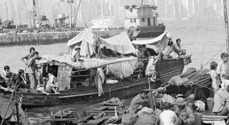 Vietnamese refugees living in their boats at the Government Dockyard in Kowloon, Hong Kong. 1979