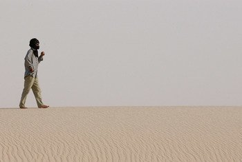 A man walks on the desert road between the Dakhla Refugee Camp and Awsaard Refugee Camp.