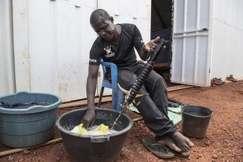A peacekeeper from Senegal, serving in the United Nations Multidimensional Integrated Stabilization Mission in the Central African Republic (MINUSCA), performs weapon maintenance at the MINUSCA field office camp in Bangassou.