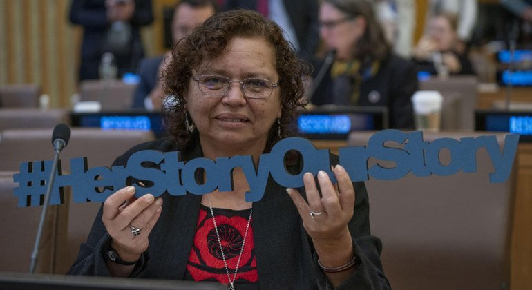 """Morena Herrera, social activist from El Salvador, holds the sign """"Her Story Our Story"""" at the launch of the Spotlight Latin America programme, which will fund targeted interventions, aiming to eradicating femicide in Latin America."""