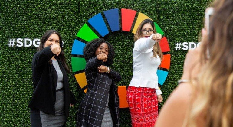 Participant of events held on the first day of the high-level week of the seventy-third session of the General Assembly pose in front of the Sustainable Development Goals emblem. 24 September 2018.