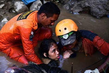 A 15-year old girl is rescued from the rubble of her house in central Sulawesi on 30 September 2018.