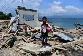 Rido Saputra, 10 years old, stands in front of his home which was destroyed by the tsunami in Donggala Regency, Central Sulawesi, Indonesia (3 October).