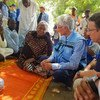 UN Emergency Relief Coordinator Mark Lowcock (2nd r) and UNDP Administrator Achim Steiner (r) with the head of the Nigeria State Emergency Management Agency (middle), speaking with a group of farmers from the border town of Banki in Borno state, Nigeria on 6 October 2018.