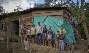 A family of Venezuelan children and their older Colombian-born relatives stand outside their wooden house in Barrio Camilo Daza in the city of Cúcuta, Colombia. Mother of four, Aide Caceres (far left) recently brought her children here because of the situation in Venezuela, but is unable to access health and education for them as they are undocumented Venezuelans.