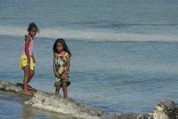 Children in the village of Tebikenikora, in Kiribati, Central Pacific.
