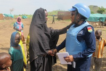 A peacekeeper is interacting with Internally Displaced Person at Aralciro gathering site, Golo locality, Central Jabal Marra, Darfur, Sudan.
