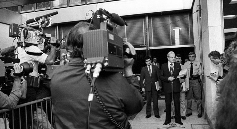 In July 1982, the UN Secretary-General Javier Perez de Cuellar (at microphone) briefs the media at UN headquarters in New York after meeting British and Argentinian negotiators in the Falkland Islands/Malvinas crisis.