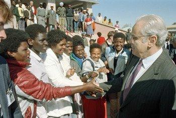 The UN Secretary-General Javier Perez de Cuellar visits  Katatura, a black township of Windhoek, Namibia in July 1989.