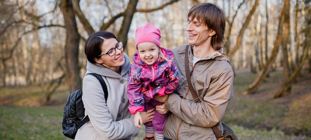 Olga and Andrey with their three year old daughter Yulia.  Olga and Andrey say they would like a larger family but do not have more children due to limited economic means.  Belarus, 2018.