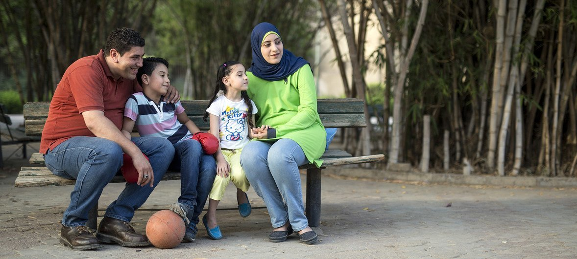 Ahmed and Rasha enjoying a picnic in the Japanese Park in Helwan neighborhood in Cairo, Egypt, with their two children, Mohamed and Raghad.  Ahmed and Rasha have chosen to not have any more children because they want to ensure they can provide Ahmed and Raghdad a good life and good education.
