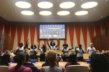 A group of teen advocates for girls rights perform a skit on the barriers women and girls face in social life, school, and the workforce during the